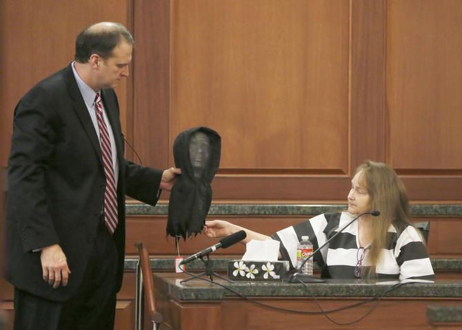 "Lead prosecutor Bill Wirskye held up the mask worn by Eric Williams during the killing of Mark Hasse as Kim Williams testified Tuesday. She described how she'd driven her husband to carry out their plot, but just ""couldn't watch him kill someone."""