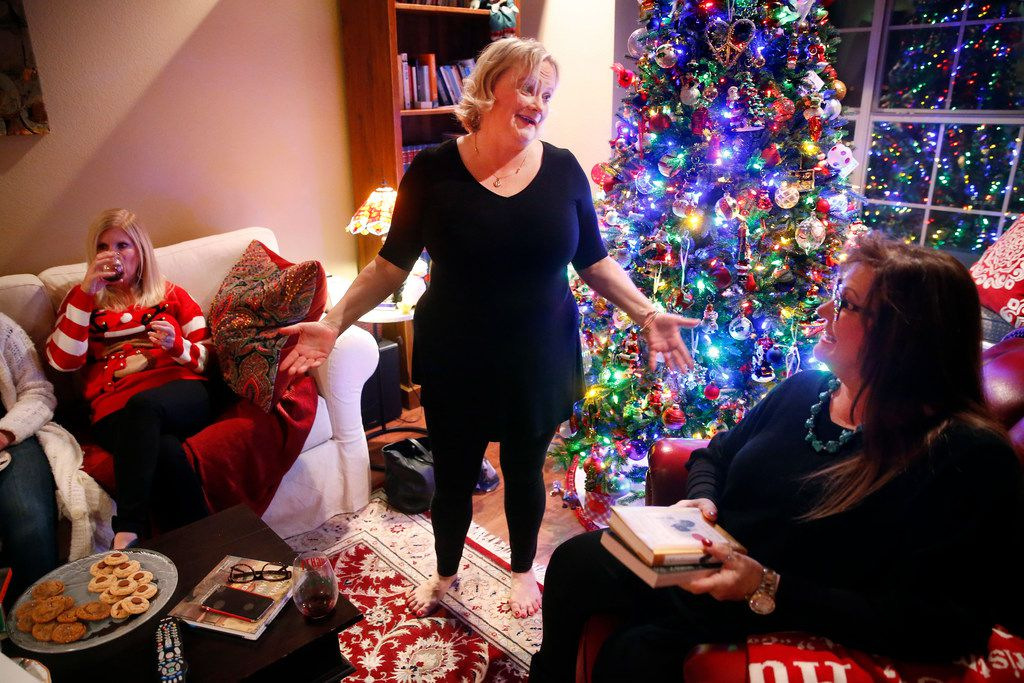 Secret Society of Happy People founder Pamela Johnson (center) visits with Victoria Boyd of Lewisville at a monthly book club get-together at her home on Dec. 14, 2017. The Society started almost 20 years ago. She also started the blog #happinessunites, which includes her experiences on tour.