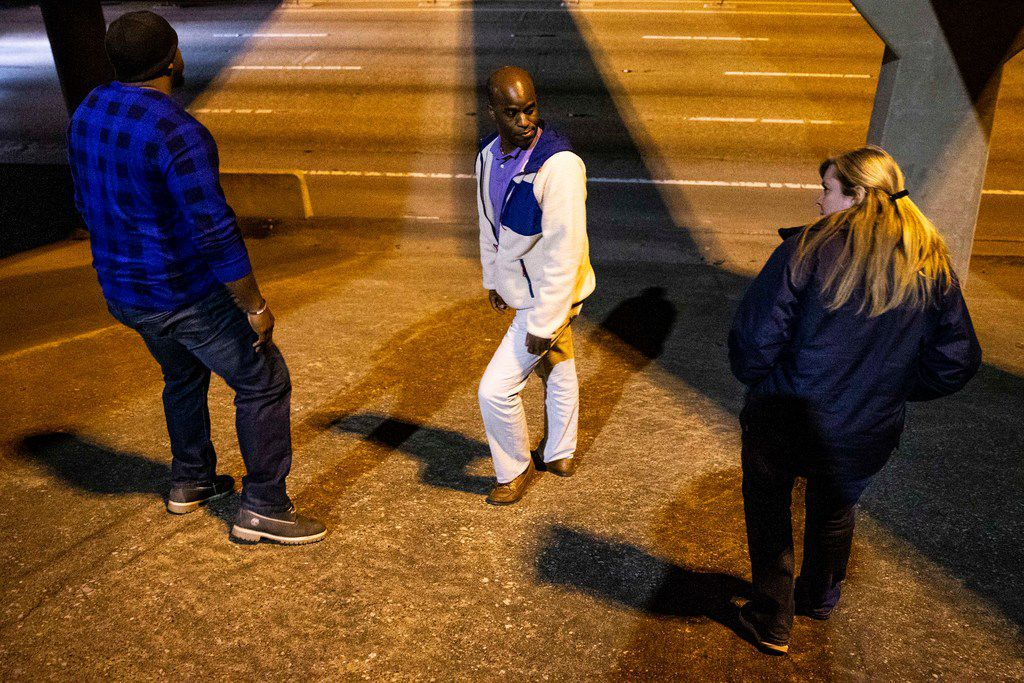 Ben Bailey, left, search for homeless people along with his coworkers at Metrocare Ikenna Mogbo, middle, and Hope Stedman during the annual homeless count in Dallas on Thursday, Jan. 24, 2019.