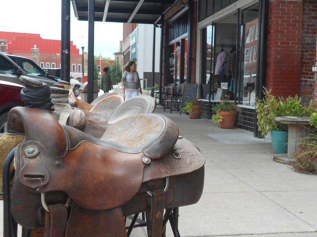 Downtown Pawhuska is a working cowboy town where saddles can be found for sale along the sidewalks along with boots, lariats and spurs.