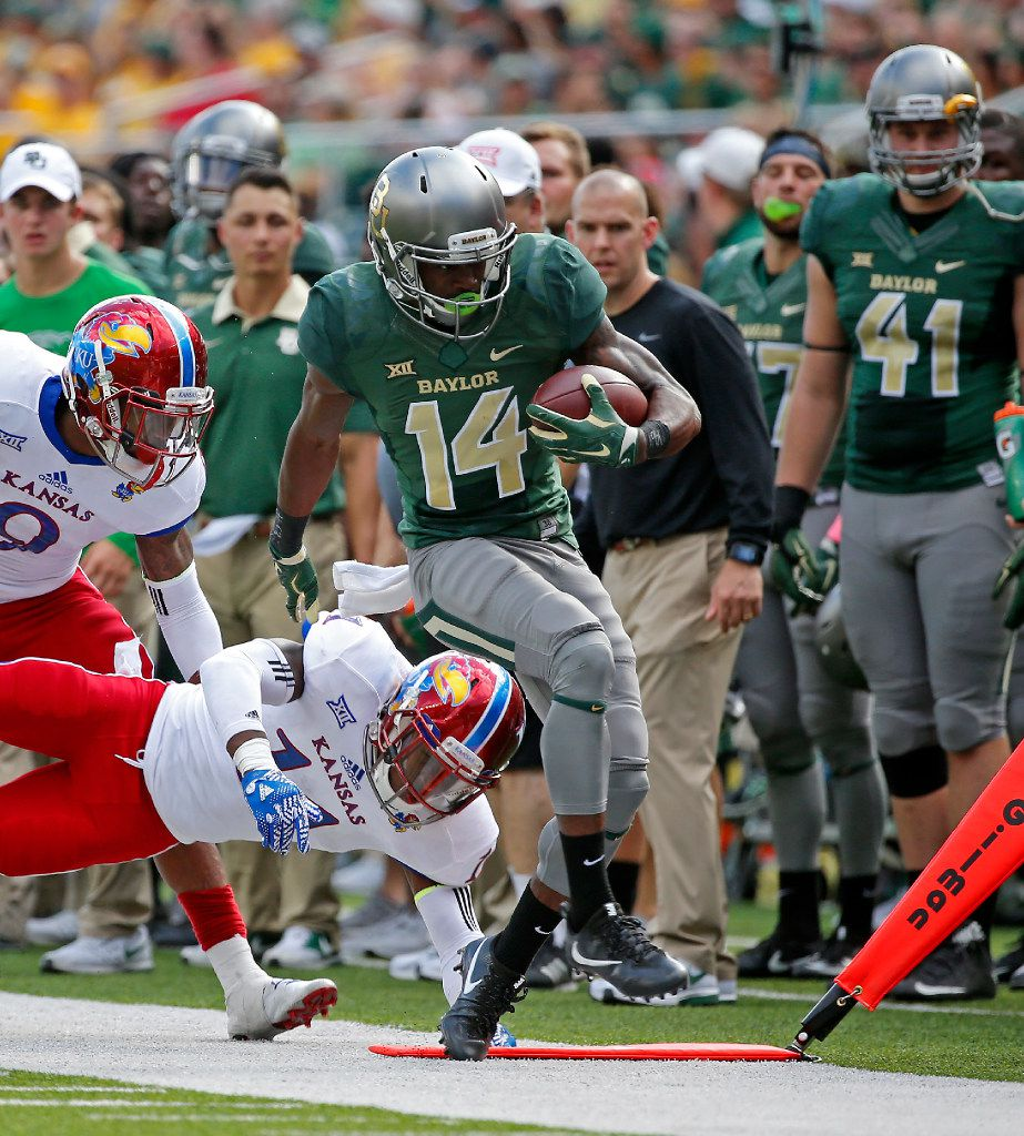 Baylor wide receiver Chris Platt (14) is pushed out of bounds by Kansas linebacker Mike Lee (11) after getting a first down during the second quarter at McLane Stadium in Waco, Texas, Saturday, Oct. 15, 2016. (Jae S. Lee/The Dallas Morning News)