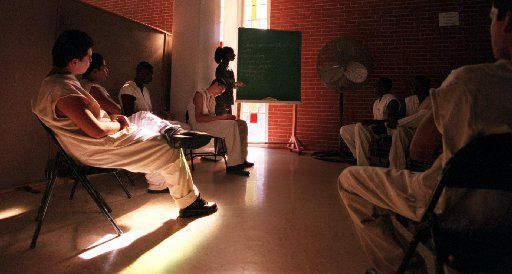 Inmates who are in the 'Youthful Offender Program' attend a counseling session at the chapel  at the Clemens Unit in Brazoria on Dec. 5, 1999.