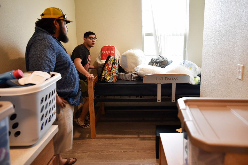 Freshman Isaac Lleverino (right), 18,  and Charlie Perez rearrange Isaac's dorm room at UNT-Dallas.