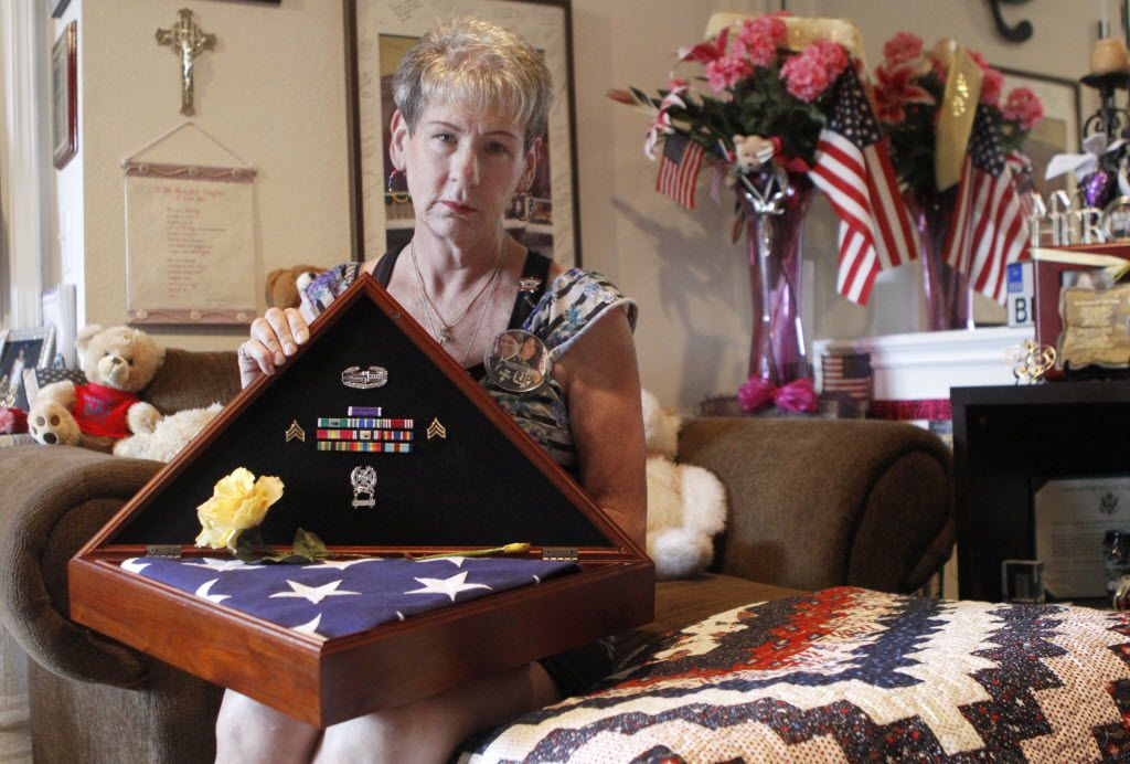 Margy Agar received a flag and ribbons at the funeral of her daughter, Kim Agar, who died last October at age 25. Margy made sure Kim was posthumously awarded the Purple Heart for her injuries from an IED attack.