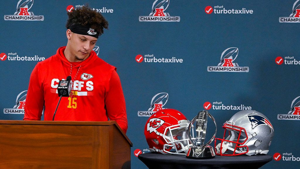 Kansas City Chiefs quarterback Patrick Mahomes looks at the Lamar Hunt Trophy during a news conference in Kansas City, Mo., on Wednesday, Jan. 16, 2019, ahead of the AFC Championship game against the New England Patriots. (John Sleezer/Kansas City Star/TNS)