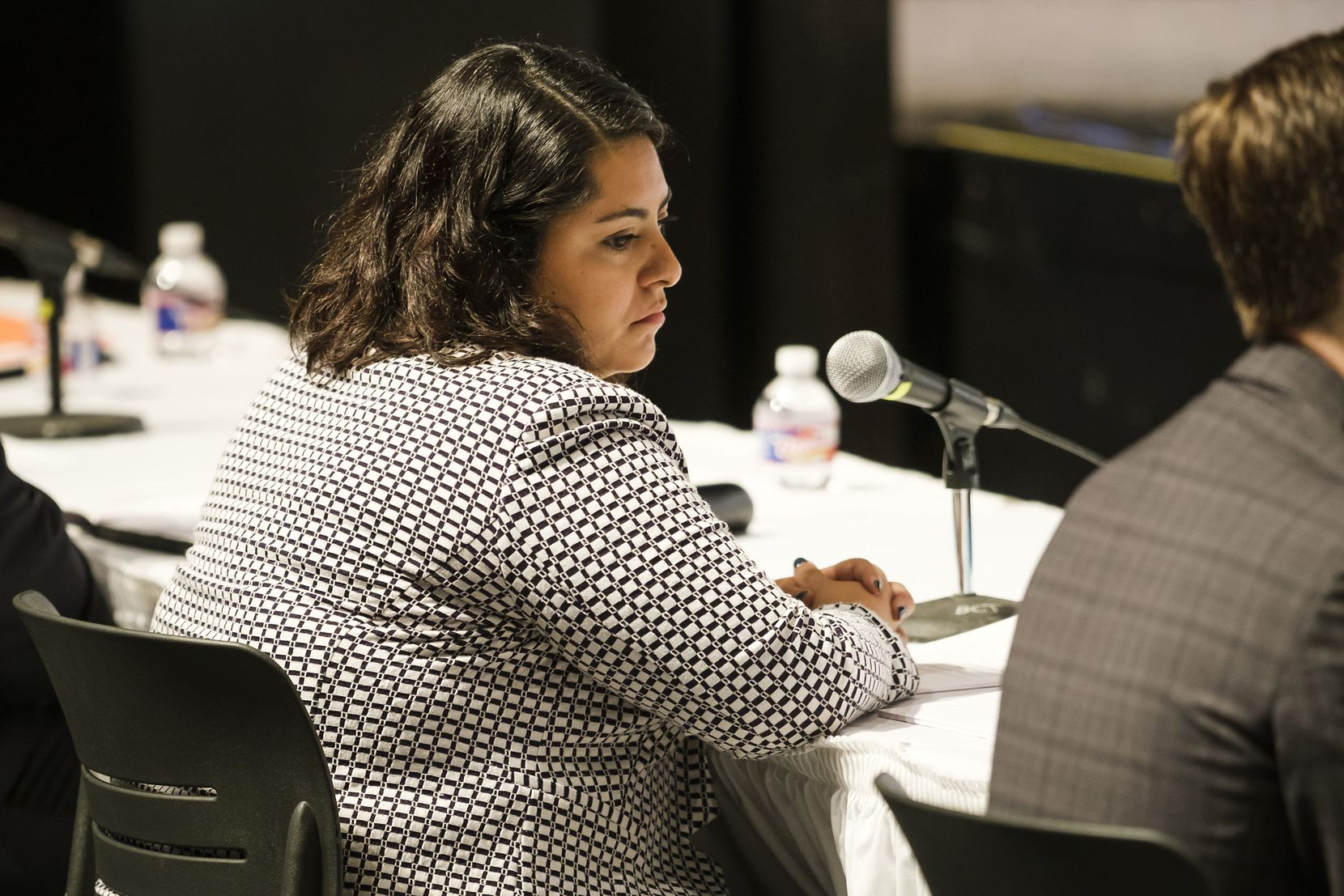 Ana Martinez, Facebook's Southwest head of public policy and community engagement, listens to testimony during a Texas House Select Committee on Mass Violence Prevention and Community Safety hearing at Brookhaven College on Thursday, Oct. 10, 2019, in Dallas.  The meeting is one of several the committee is holding across the state following the recent mass shootings in El Paso and Odessa.
