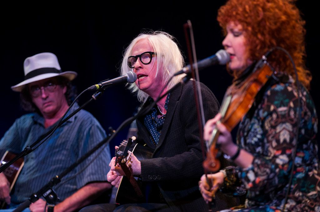 James McMurtry (left) watches as Chris Masterson and Eleanor Whitmore of The Mastersons perform at Lampadusa: Concerts for Refugees in Dallas.