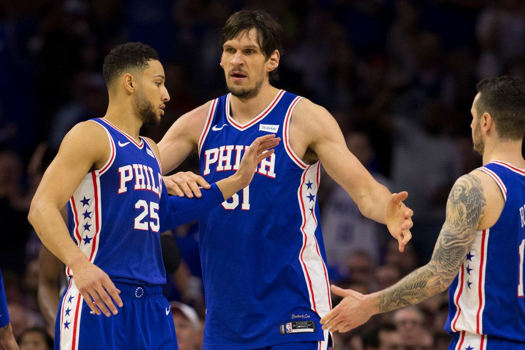 Ben Simmons #25, Boban Marjanovic #51, and JJ Redick #17 of the Philadelphia 76ers react against the Brooklyn Nets in Game Five of Round One of the 2019 NBA Playoffs at the Wells Fargo Center on April 23, 2019 in Philadelphia, Pennsylvania. (Mitchell Leff/Getty Images/TNS)