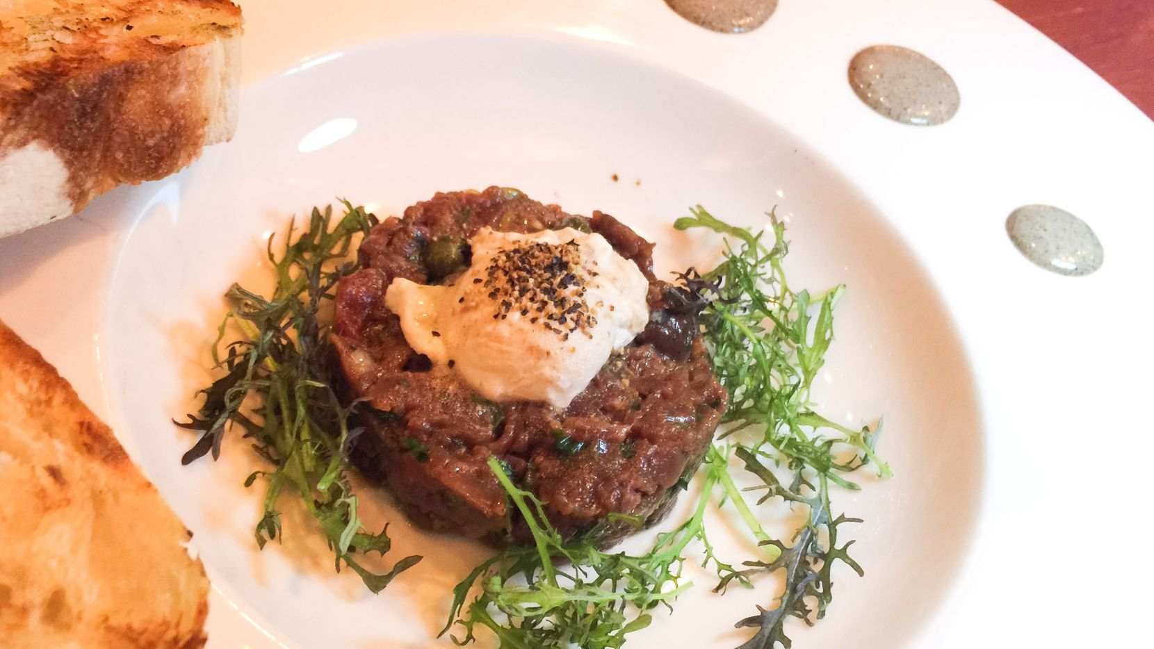 """Chef Nick Amoriello's venison tartare at Kitchen LTO. Amoriello is in charge of the kitchen for a sixth-month stint chef at the """"permanent pop-up"""" restaurant in Trinity Groves. Game meats such as antelope and rabbit are spotlighted on his menu."""