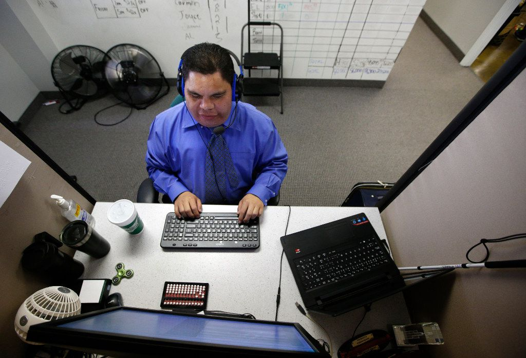 Al Rodriguez works at his desk in the call center at Bold Sales Solutions, a subsidiary of Dallas Lighthouse for the Blind in Dallas on June 30, 2017.  (Nathan Hunsinger/The Dallas Morning News)