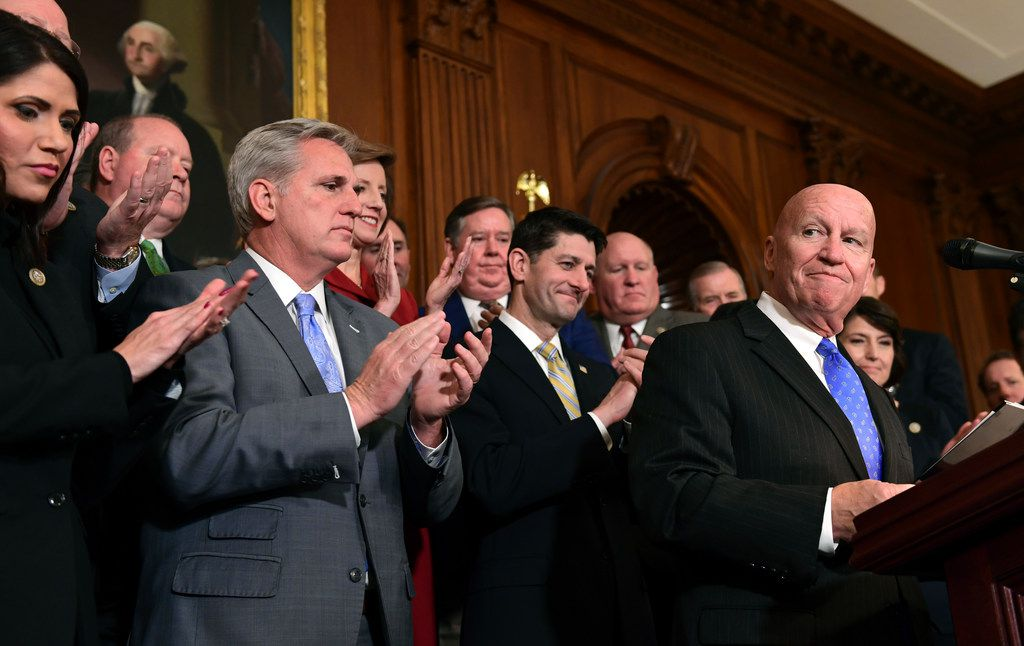 House Ways and Means Committee Chairman Rep. Kevin Brady, R-Texas, right, pauses as he speaks during a news conference following a vote on tax reform on Capitol Hill in Washington, Thursday, Nov. 16, 2017. Republicans passed a near $1.5 trillion package overhauling corporate and personal taxes through the House, edging President Donald Trump and the GOP toward their first big legislative triumph in a year in which they and their voters expected much more. (AP Photo/Susan Walsh)