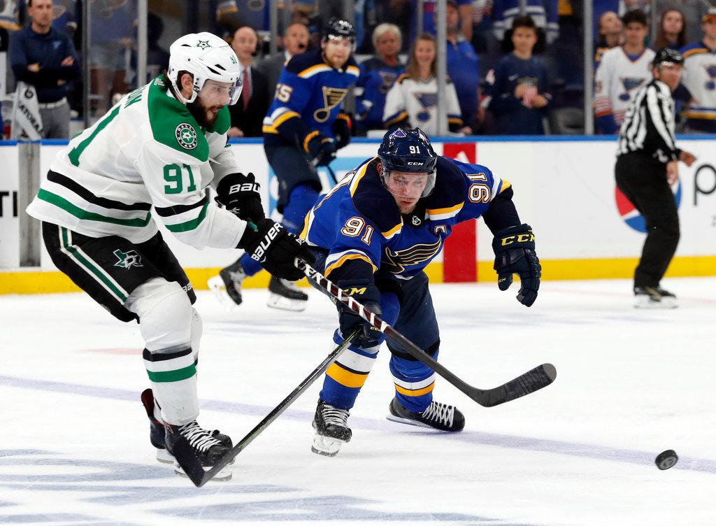 Dallas Stars' Tyler Seguin, left, and St. Louis Blues' Vladimir Tarasenko, right, compete for control of the puck during overtime in Game 7 of an NHL second-round hockey playoff series, Tuesday, May 7, 2019, in St. Louis. (AP Photo/Jeff Roberson)