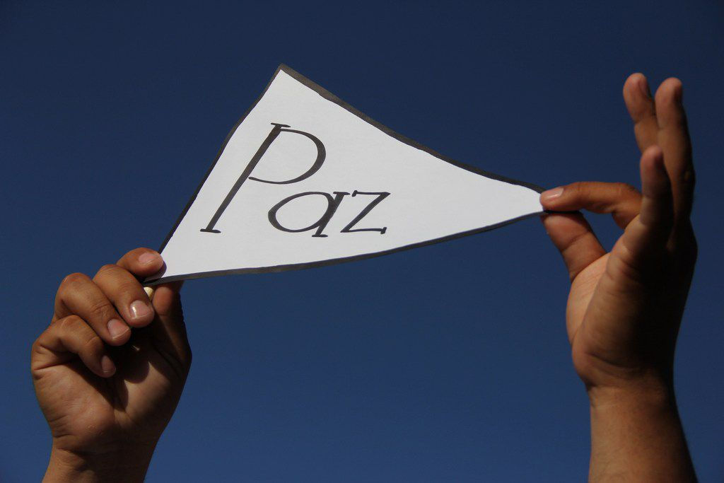 """A man held a sign reading """"peace"""" during the march for peace and against violence in Ciudad Juarez, Mexico, on June 23. At least 14 people were killed on that day in three different incidents in Juarez on the U.S. border. June and July each ended with 177 dead in the city."""