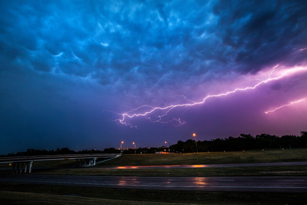 In this June file photo, lightning fills the sky over State Highway 360 near Euless.