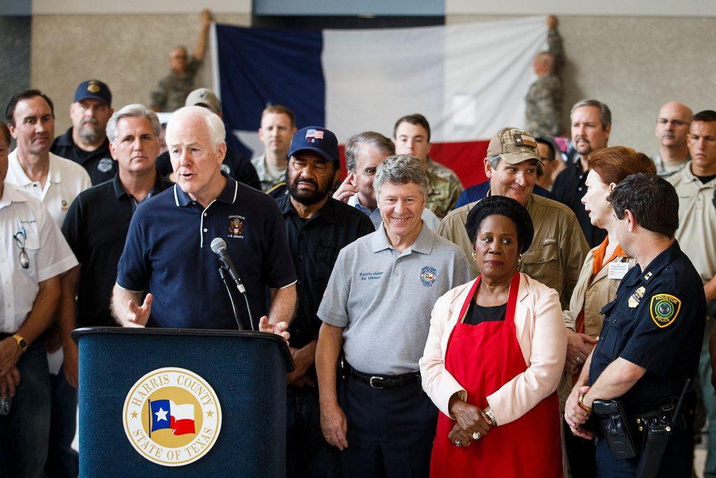 U.S. Sen. John Cornyn is surrounded by fellow lawmakers and law enforcement as he addresses a press conference at the evacuation center at NRG Center on Monday, Sept. 4, 2017, in Houston. A group of elected officials met with evacuees and held a brief news conference in an effort to drum up support for emergency aid for Harvey victims.