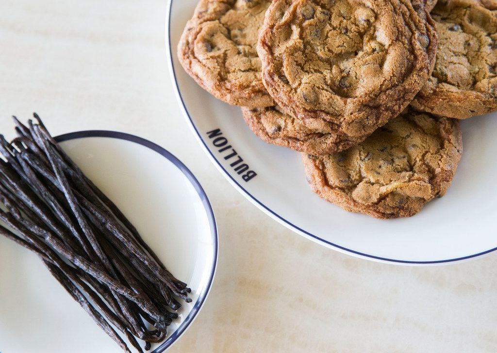 """Vanilla beans and chocolate chip cookes at Bullion restaurant in Dallas on March 8, 2019. According to Martha Stewart's website, a kilo of vanilla beans cost $100 in 2015, with the cost rising to """"a whopping $600,"""" when the post was written Sept. 18, 2017. (Daniel Carde/The Dallas Morning News)"""