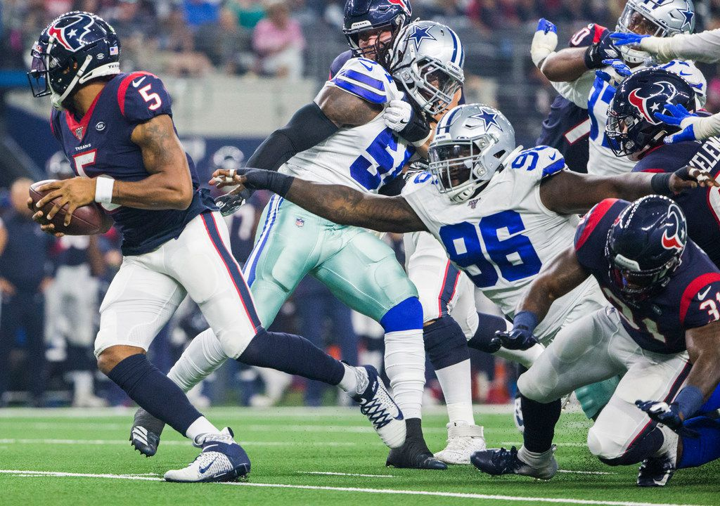 Dallas Cowboys defensive tackle Maliek Collins (96) reaches for Houston Texans quarterback Joe Webb (5) during the first quarter of an NFL game between the Dallas Cowboys and the Houston Texans on Saturday, August 24, 2019 at AT&T Stadium in Arlington.
