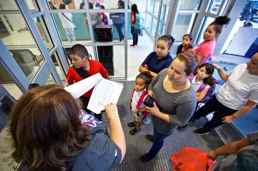 Bilingual teacher assistant Marta Gomez helped direct parents and students to their classrooms on the first day of school at Jose May Elementary School in Dallas on Aug. 22, 2016.