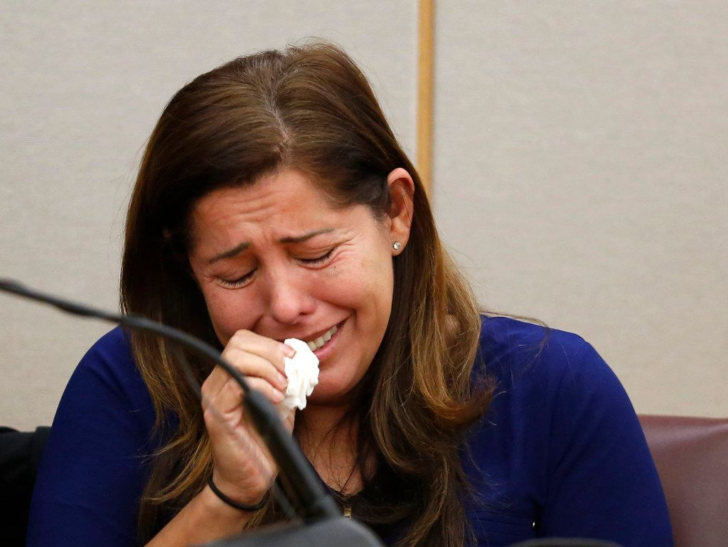 Ingrid Llerena, Roy Oliver's wife, cries while testifying about her husband, asking for leniency from the jury. (Rose Baca/Staff Photographer)