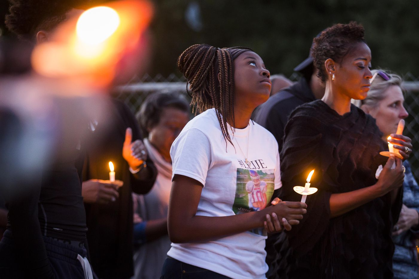 """Ashuntae Coleman, 14, stands with her mother Demetria Brown (right) attend the """"Remember His Name: Vigil for Jordan Edwards"""" candlelight vigil at Virgil T. Irwin Park on Thursday, May 4, 2017, in Balch Springs, Texas."""