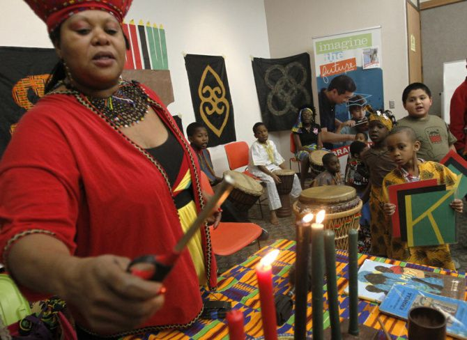 "Storyteller Melody ""Afi"" Bell will lead a  program of stories and songs that relate the history of Kwanzaa Dec. 26 at Bookmarks in NorthPark Center. Here she lights the candles at the South Oak Cliff Kwanzaa celebration last year."