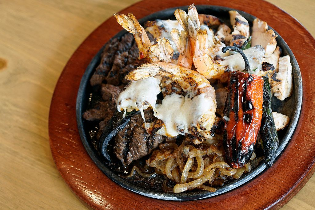 The Grandioso at Lupe Tortilla lives up to its name: It's a $56.95 plate that feeds two to three people. It comes out sizzling, with 1 pound of beef and chicken fajitas and six bacon-wrapped pepper shrimp.
