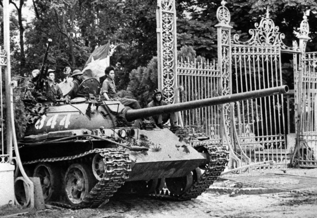 A North Vietnamese tank rolls through the gates of the Presidential Palace in Saigon, signifying the fall of South Vietnam.