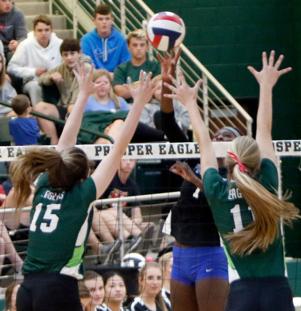 Iman Ndiaye (1), from Plano West, powers a shot past Prosper defenders Nikki Steinheiser (15) and Shaylee Shore(11) during the second game of their match. The two teams played their District 9-6A volleyball match at Prosper High School in Prosper on October 22, 2019. (Steve Hamm/ Special Contributor)