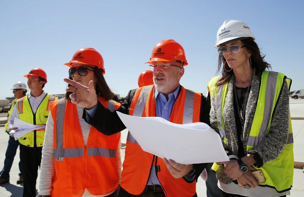 Harry Mark (center), FAIA of RSM Design points out one of the signs to Charlotte Jones Anderson (right) Executive Vice President and Chief Brand Officer for the Dallas Cowboys and Jennifer Surgalski, Senior Director, Corporate Partnership Services Dallas Cowboys at the Dallas Cowboys new headquarters at The Star in Frisco, on Tuesday, May 3, 2016. The Star a joint project with the City of Frisco is scheduled to open in August. (Vernon Bryant/The Dallas Morning News)