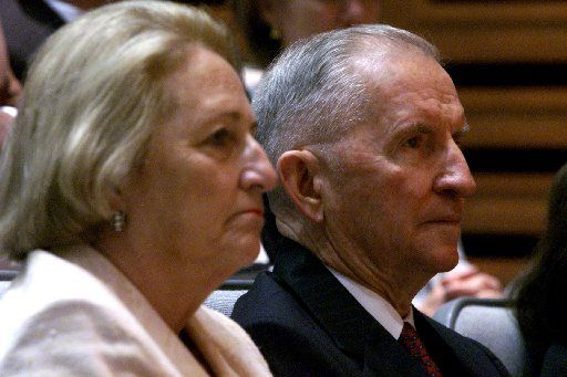 Ross and Margot Perot listen in 2002 as UT Southwestern Medical Center's president Kern Wildenthal talks about the $450 million campaign to accelerate medical research at UT Southwestern campus.