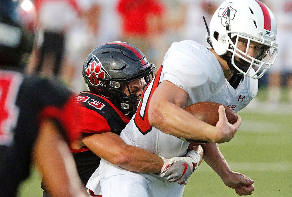 Lovejoy High School running back Austin King (20) looks at defenders closing in as Colleyville Heritage High School linebacker Matthew Powers (33) holds on and waits for help during the first half as Colleyville Heritage High School hosted Lovejoy High School as part of the Tom Landry Classic at Eagle Stadium in Allen on Saturday, August 31, 2019. (Stewart F. House/Special Contributor)