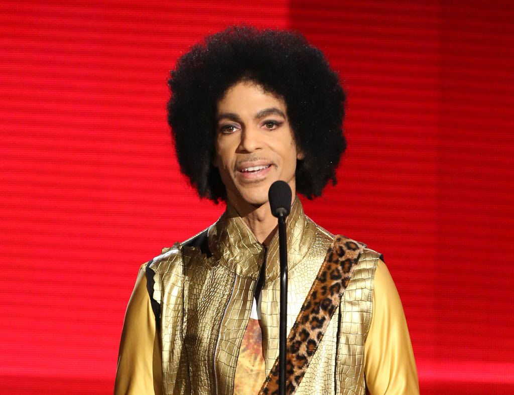 In this Nov. 22, 2015 file photo, Prince presents the award for favorite album - soul/R&B at the American Music Awards in Los Angeles. A law-enforcement official says that tests show the music superstar died of an opioid overdose. Prince was found dead at his home on April 21, 2016, in suburban Minneapolis. He was 57.