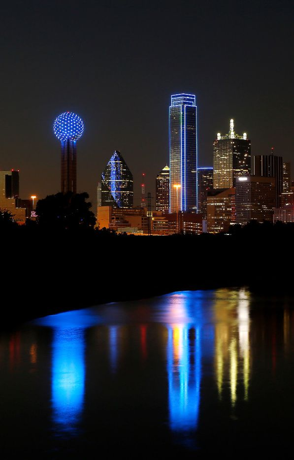 Reunion Tower (left) and Bank of America Plaza are lit in blue in honor of five police officers killed by the ambush attack in downtown Dallas, Tuesday, July 12, 2016. (Jae S. Lee/The Dallas Morning News)