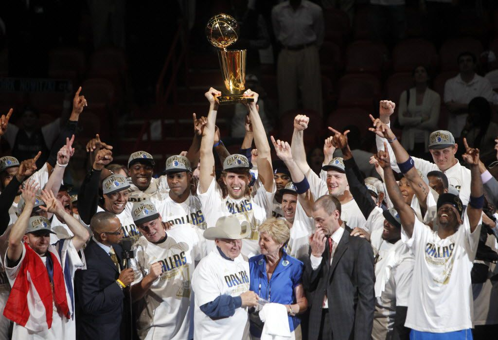 FILE - The Dallas Mavericks celebrate with the Larry O'Brien Trophy after winning Game 6 of the NBA Finals against the Miami Heat at American Airlines Arena in Miami on June 12, 2011. (Vernon Bryant/The Dallas Morning News)