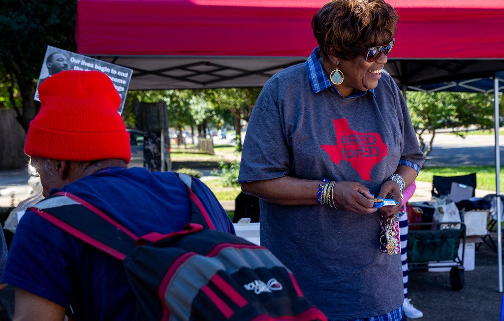 Delna Bryan, president of National Education Association Dallas, smiles as an attendee talks to one of the organizer during an event to encourage voters to support candidates who are friendly to public education at Martin Luther King, Jr. Community Center in Dallas on Saturday, October 27, 2018. (Shaban Athuman/The Dallas Morning News)