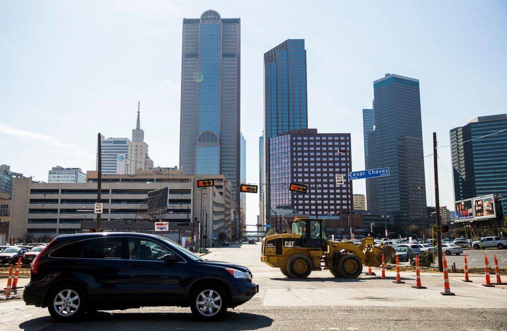 Traffic squeezes through a construction zone on Cesar Chavez Boulevard.