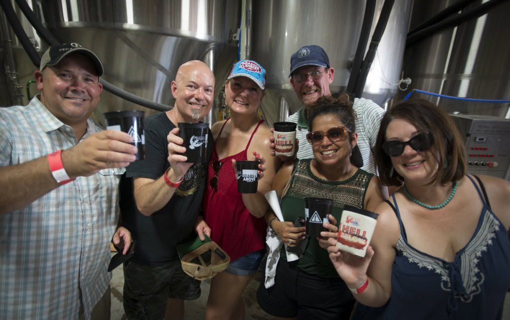 A pack of beer fans lift their cups at Martin House Brewing Company in Fort Worth, Texas on June 26, 2016. They are, from left to right, Chris Daniel, Jeff Gray, Whitney Gray, John Adams, Beckie Fernandez and Angie Girgenti.