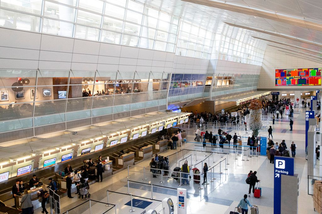 Travelers make their way through Terminal D at DFW International Airport on Friday, Dec. 21, 2018. This terminal was opened in 2005.  (Shaban Athuman/The Dallas Morning News)