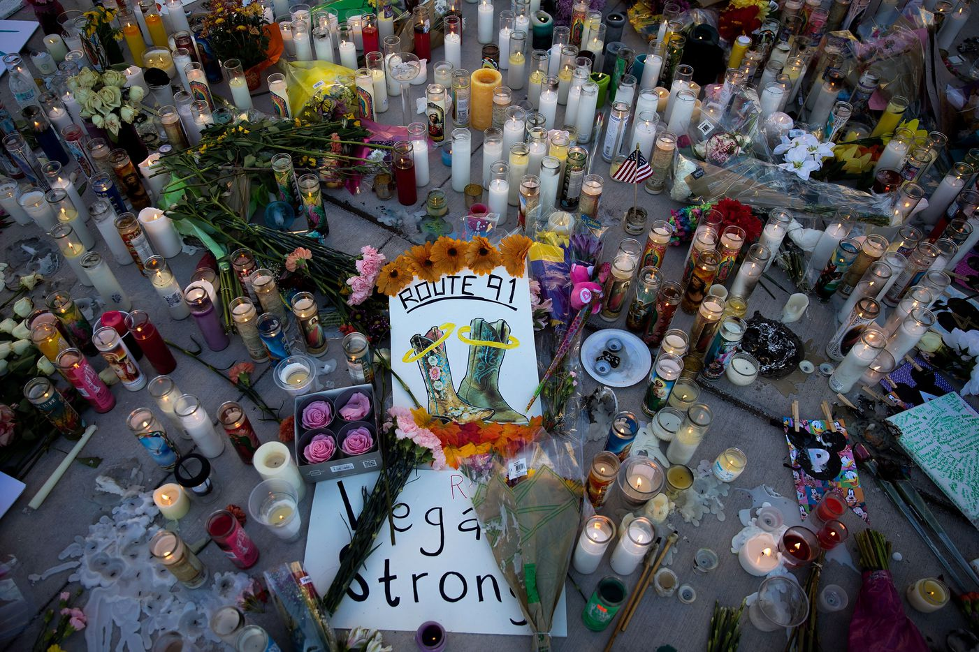 LAS VEGAS, NV - OCTOBER 3: A makeshift memorial for the victims of Sunday night's mass shooting stands at an intersection of the north end of the Las Vegas Strip, October 3, 2017 in Las Vegas, Nevada. The gunman, identified as Stephen Paddock, 64, of Mesquite, Nevada, allegedly opened fire from a room on the 32nd floor of the Mandalay Bay Resort and Casino on the music festival, leaving at least 58 people dead and over 500 injured. According to reports, Paddock killed himself at the scene. The massacre is one of the deadliest mass shooting events in U.S. history. (Photo by Drew Angerer/Getty Images)