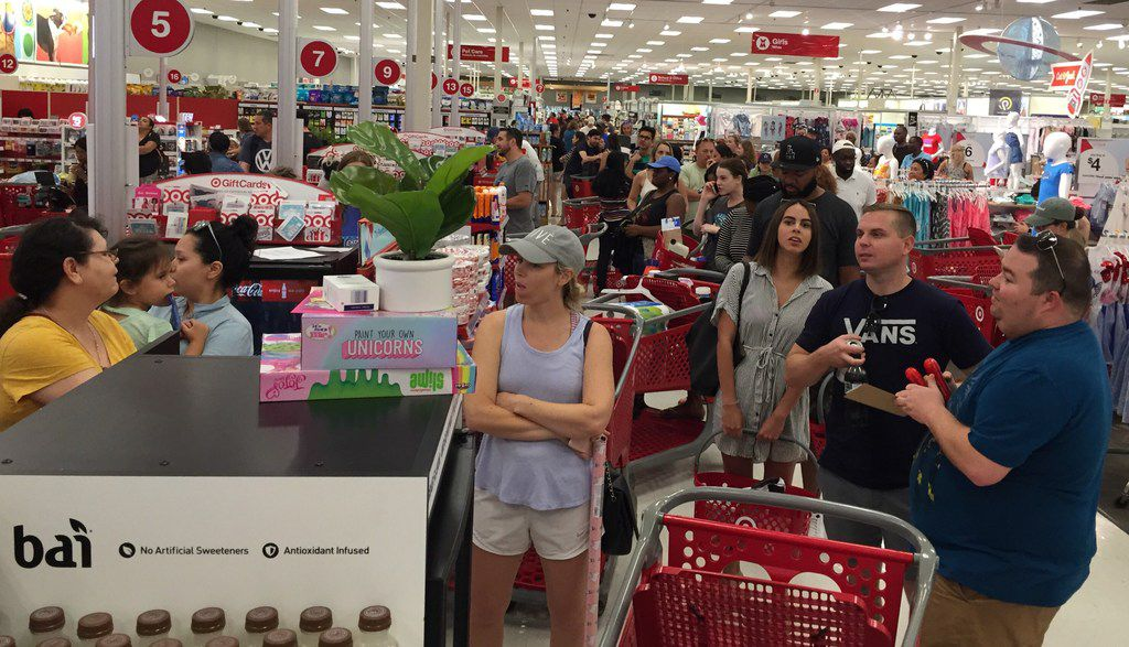Target customers waited in long lines at the store on North Haskell Avenue on Saturday afternoon in Dallas.      A system glitch at Target stores clogged checkout aisles nationwide.