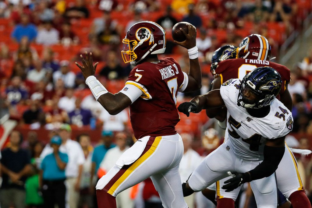 Washington Redskins quarterback Dwayne Haskins (7) throws the ball under pressure from Baltimore Ravens linebacker Tyus Bowser (54) during the first half of an NFL preseason football game Thursday, Aug. 29, 2019, in Landover, Md.