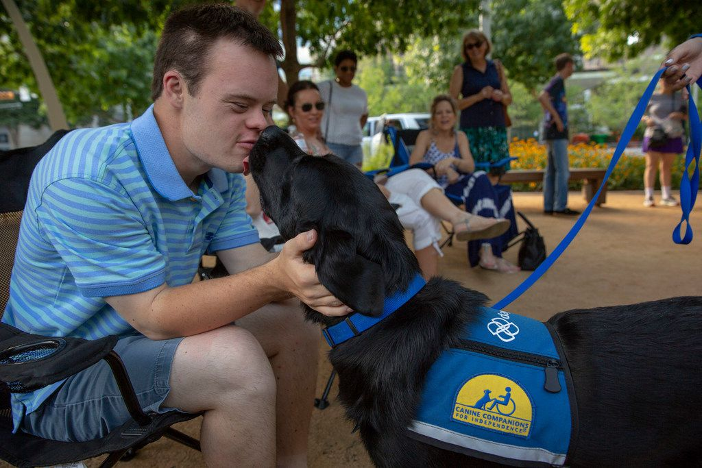 Nick Jones meets Yoshi, a 2 year-old labrador retriever and golden retriever mix that will be the service dog at Daymark Living, a special needs community soon opening in Waxahachie. Daymark Social Club meets regularly throughout the Dallas/ Fort Worth area in locations like Klyde Warren Park in Dallas, Texas, Saturday, June 16, 2018.