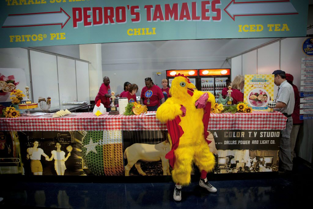 A man in a chicken suit dances as competitors prepare their entries during the 2016 Big Tex Choice Awards Sunday, August 28, 2016 at Fair Park in Dallas. The annual event, held ahead of the State Fair of Texas, recognizes the best fried foods entered into consideration for sale at the fair. (G.J. McCarthy/The Dallas Morning News)