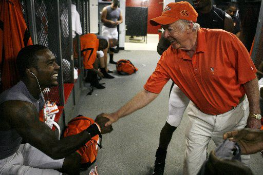 T.Boone Pickens Jr. shakes Dez Bryant's  hand as he makes the rounds greeting all Oklahoma State University players before their game against The University of Georgia at Sanford Stadium in Athens, Georgia September 1, 2007.  09122013xSPORTS