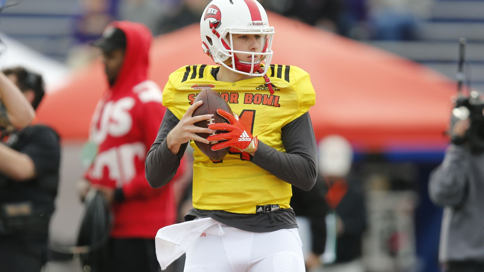 FILE - South Squad quarterback Mike White of Western Kentucky during South team's practice for Saturday's Senior Bowl college football game in Mobile, Ala., Wednesday, Jan. 24, 2018. (AP Photo/Brynn Anderson)