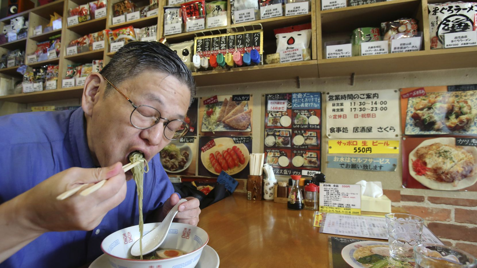 Masaya Sokusekisai Oyama, 55, slurps noodles at a Tokyo shop and restaurant specializing only in varieties of instant noodles.