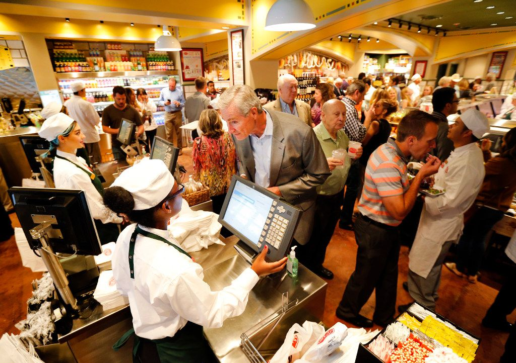 Guests check out at the cash register during VIP night at the new Eatzi's Market & Bakery at University Park Village in Fort Worth on May 9.