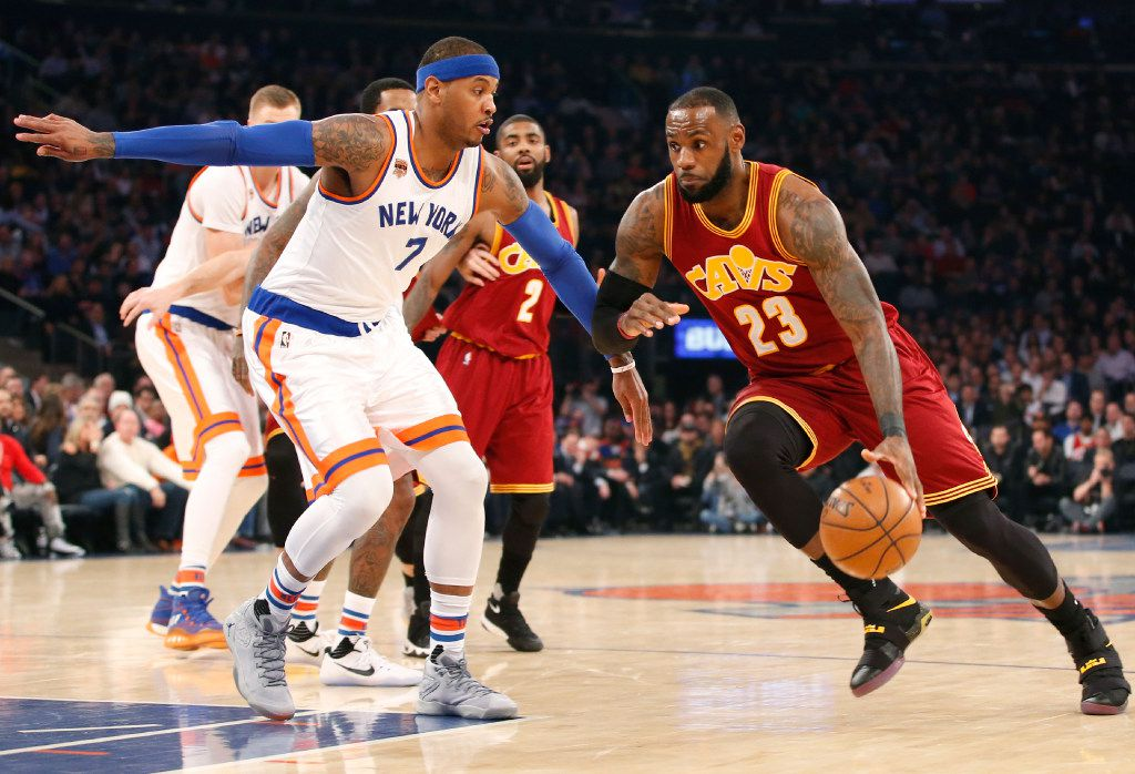 Cleveland Cavaliers forward LeBron James (23) drives to the basket with New York Knicks forward Carmelo Anthony (7) defending in the first quarter of an NBA basketball game at Madison Square Garden in New York, Wednesday, Dec. 7, 2016. (AP Photo/Kathy Willens)