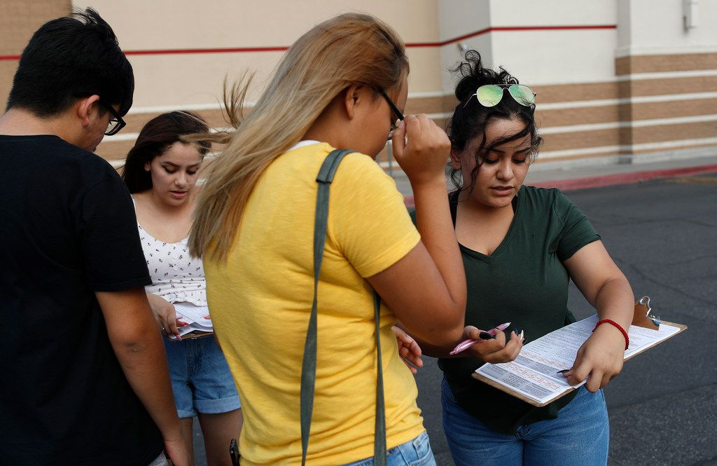 Maria Nieto (right) and Alma Romo (second from left) registered people to vote in Las Vegas in August 2018. Democrats in Nevada are working to register and engage Latino voters ahead of this year's midterms, hoping to re-create the big wins that the state's Hispanic and immigrant community are credited with delivering two years ago.