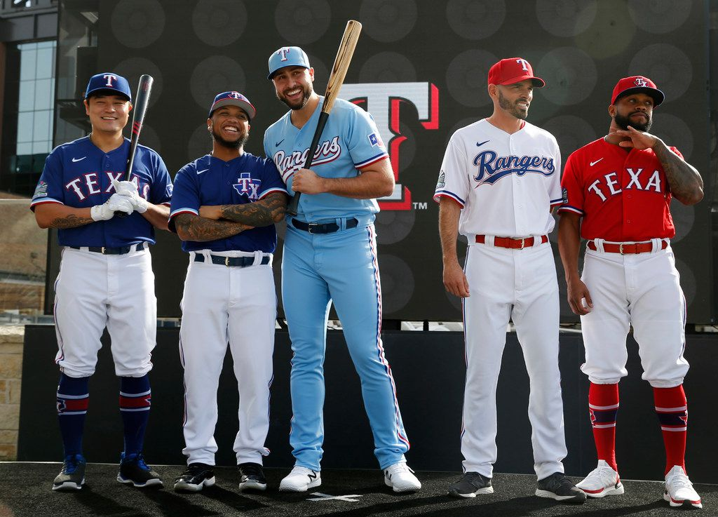 Texas Rangers Shin-Soo Choo, Willie Calhoun, Joey Gallo, Chris Woodward, and Delino DeShields on stage during the unveiling of the 2020 uniforms at Live! next to Globe Life Field in Arlington, Texas on Wednesday, December 4, 2019. (Vernon Bryant/The Dallas Morning News)